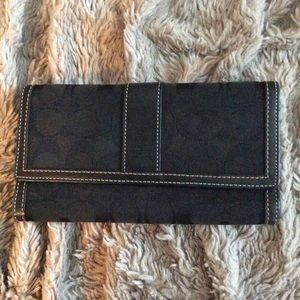 Coach wallet. Black. Used. Good condition.